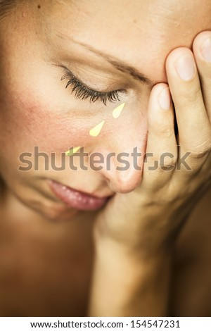faked tears - stock photo