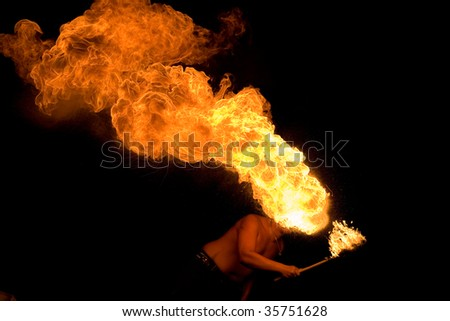 Fakir blowing fire from his mouth - stock photo