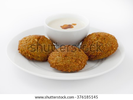 Falafel appetizer with sauce, part of a Greek, Mediterranean or Middle Eastern Diet, - stock photo
