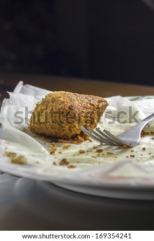 Falafel left overs, bread and fork - stock photo