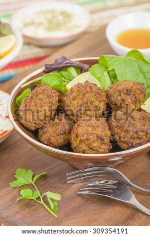 Falafel - Middle Eastern deep fried balls made of chickpeas.