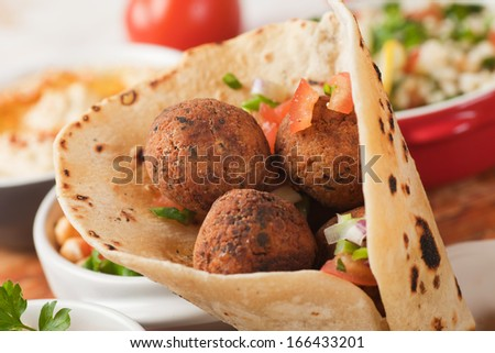 Falafel, middle eastern deep fried chickpea balls with pita bread - stock photo