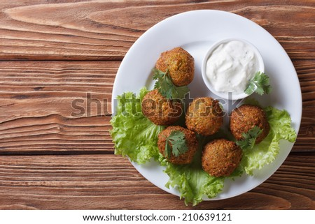 falafel on a white plate with sauce tzatziki close-up view from above horizontal   - stock photo