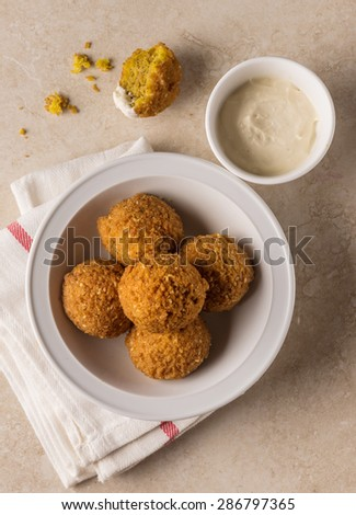 Falafel - popular middle eastern street food with garlic sauce. Top view. - stock photo