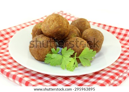 Falafel with fresh parsley on a light background