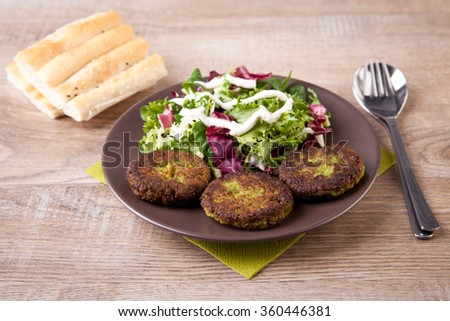 Falafel with pita bread and fresh salad - stock photo