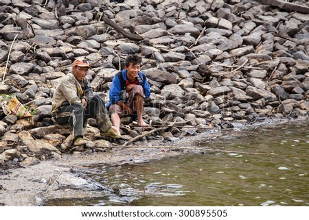 FALAM, MYANMAR - JUNE 17 2015: Fishermen at the start of the monsoon season in the recently opened to tourists Chin State region of Western Myanmar (Burma) - stock photo