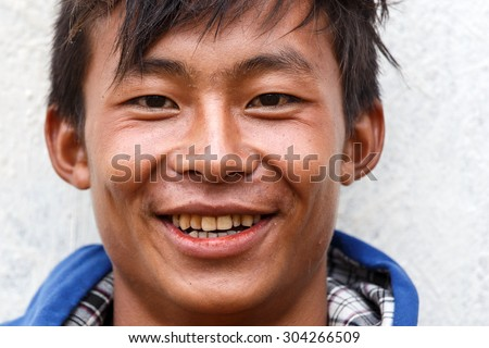 FALAM, MYANMAR - JUNE 17 2015: Local boy smiling at the start of the monsoon season in the recently opened to tourists Chin State region of Western Myanmar (Burma) - stock photo