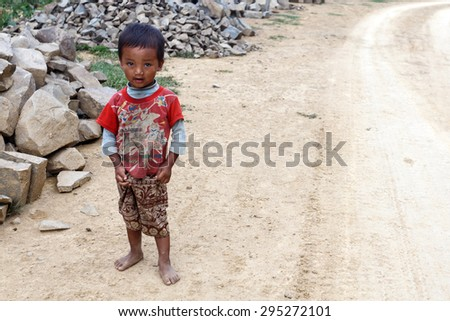 FALAM, MYANMAR - JUNE 17 2015: Local child in the recently opened to foreigners area of Chin State - western Myanmar (Burma) - stock photo