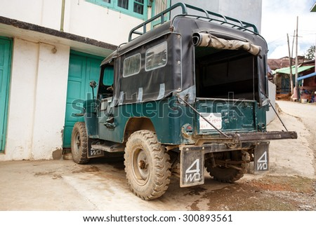 FALAM, MYANMAR - JUNE 18 2015: 4x4 Vehicle in the recently opened to foreigners area of Chin State - western Myanmar (Burma) - stock photo