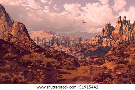 Falcon soaring above a Utah landscape. - stock photo