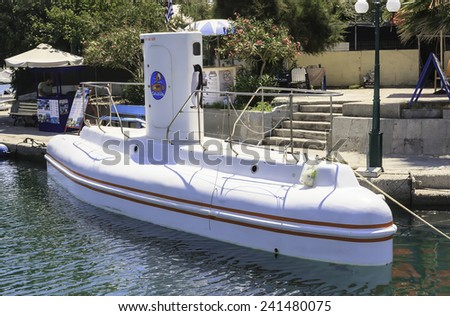 FALIRAKI, RHODES ISLAND. GREECE - JULY 27, 2014: Excursions submarine in port in Rhodes on July 27, 2014.  Rhodes is popular island among tourists to spend vacation here.