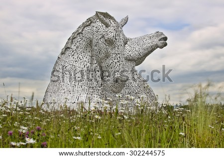 FALKIRK, UNITED KINGDOM - JUNE 30: the Kelpies sculptures on June 30, 2015 in Falkirk, United Kingdom. The Kelpies are part of The Helix land transformation project in Falkirk. - stock photo