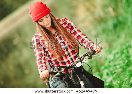Fall active lifestyle concept. Beauty young woman sporty casual girl relaxing in autumnal park with bicycle, outdoor