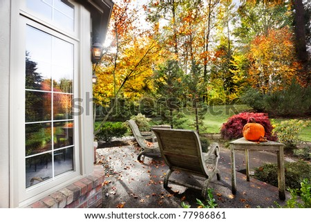 Fall afternoon sunlight on a patio and lawn - stock photo