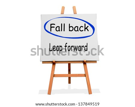 Fall Back Not Leap Forward on a sign. - stock photo
