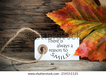Fall Background with a Label on which stands There is Always a Reason to Smile - stock photo