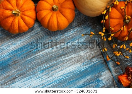 Fall background with pumpkins on blue wooden background with copy space - stock photo