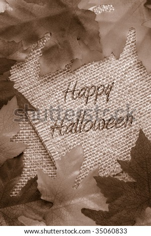 fall background with sepia leaves covering twine rope paper saying Happy Halloween