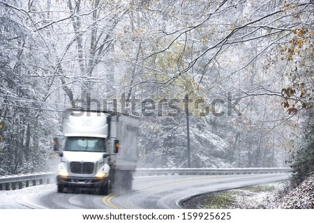 Fall color and snow, tractor trailer in hazardous highway conditions on State Route 20, Webster County, Monongahela National Forest, West Virginia, USA - stock photo
