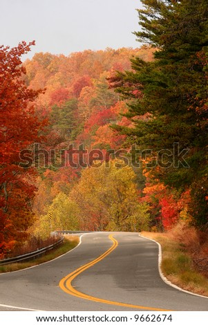 Fall color on curvy road over Fort Mountain in North Georgia - stock photo