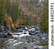 Fall Colors by Icicle Creek with water cascading over rocks - stock photo