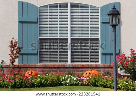 Fall decorations near a window of a single-family house - stock photo