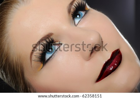 Fall fashion makeup trend. pretty woman face with bright make-up and purple lipstick - stock photo
