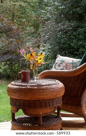 Fall flowers, steaming mug, comfy chair... - stock photo