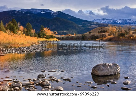 Fall foliage at its brightest along the Gardiner River, Montana. - stock photo