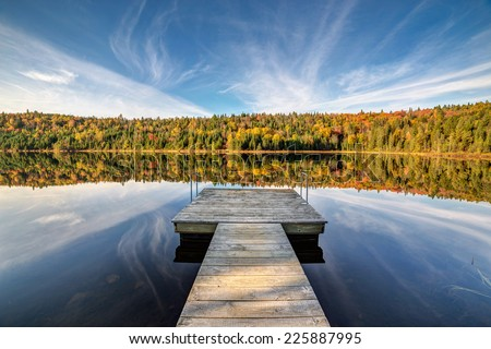 Fall foliage at the lake - stock photo