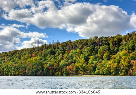 Fall foliage in New Jersey as seen from the Hudson River. - stock photo