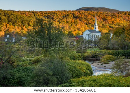 Fall Foliage landscape and Church in Stowe, Vermont.
