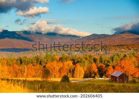 Fall foliage landscape with Mt. Mansfield in the background, Stowe, Vermont, USA - stock photo