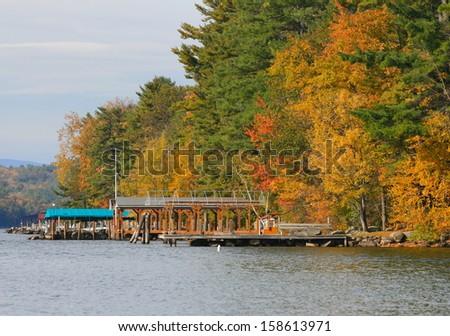 Fall foliage on Lake Winnipesaukee in Gilford New Hampshire - stock photo