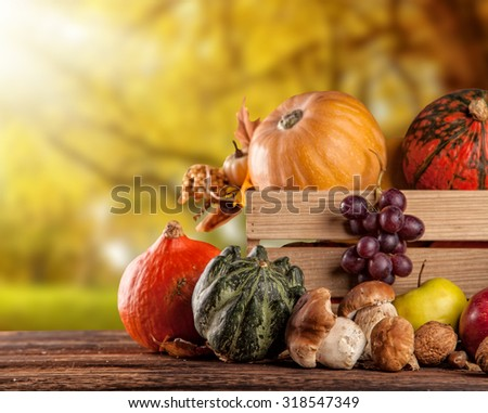 Fall fruit and vegetables in wooden box. Thanksgiving concept of harvested food