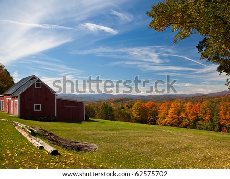 Fall leaves add color to a bright Vermont rural scene in the Fall - stock photo