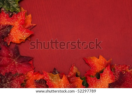Fall leaves making a border on a brown background, fall border - stock photo