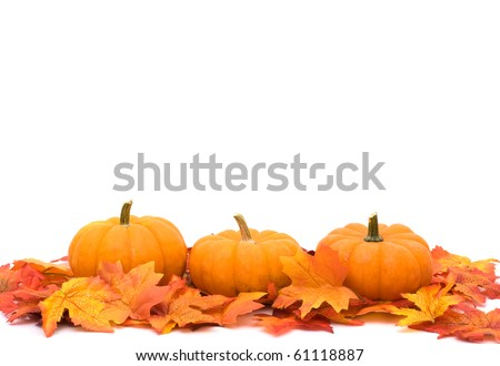 Fall leaves with a pumpkin border at the bottom, autumn background - stock photo
