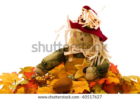 Fall leaves with a scarecrow isolated on white, autumn - stock photo