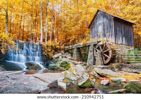 Fall or Autumn image of historic mill and waterfall in Marietta, GA - stock photo
