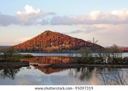 Fall scene: bluff reflected in Mississippi River in southeast Minnesota - stock photo