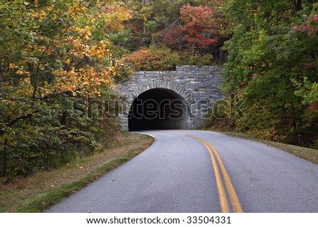 Fall scenic view of Blur Ridge Parkway and Tunnel. - stock photo