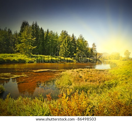 fall sunset above river - stock photo