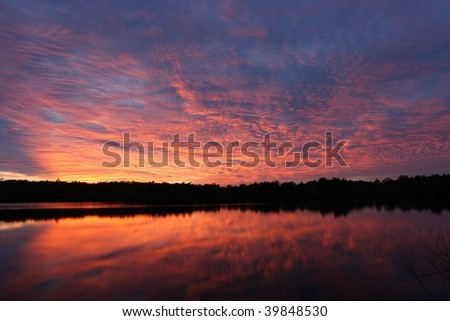 Fall sunset over a deserted lake - stock photo
