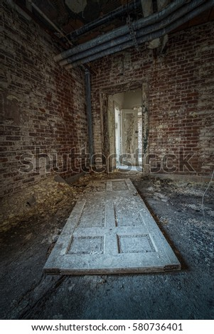 Fallen door at an abandoned facility