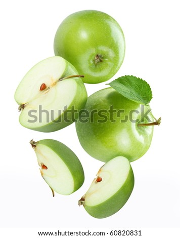 Falling apple and apple pieces - stock photo