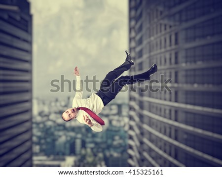 falling businessman and modern 3d urban background - stock photo