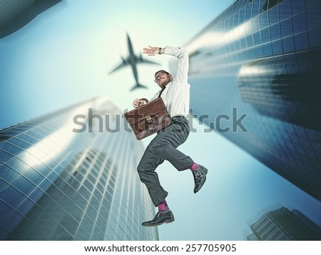 falling businessman and skyscraper background - stock photo