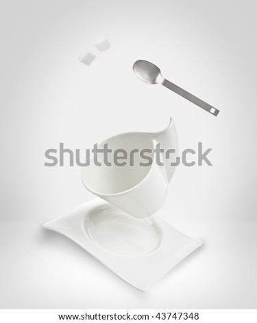 falling coffee cup - stock photo